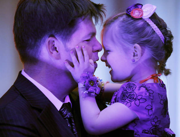 Jerimiah Russian and his daughter, Lizzie, 3, take a break from the dance floor during the Midwest City Parks and Recreation Department�s annual Daddy-Daughter Dance. Photos by Jim Beckel, The Oklahoman