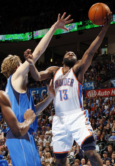 Oklahoma City's James Harden (13) shoots against Dallas' Dirk Nowitzki (41) during the NBA basketball game between the Oklahoma City Thunder and the Dallas Mavericks at Chesapeake Energy Arena in Oklahoma City, Monday, March 5, 2012. The Thunder won, 95-91. Photo by Nate Billings, The Oklahoman