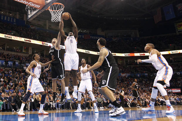 Oklahoma City's Kendrick Perkins (5) pulls in a rebound over Brooklyn Nets' Brook Lopez (11) during the NBA basketball game between the Oklahoma City Thunder and the Brooklyn Nets at the Chesapeake Energy Arena on Wednesday, Jan. 2, 2013, in Oklahoma City, Okla. Photo by Chris Landsberger, The Oklahoman