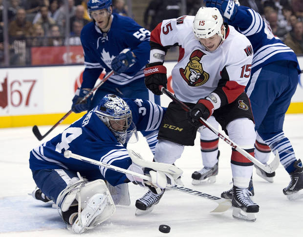 Toronto Maple Leafs goaltender James Reimer, bottom left, makes a leg-save on Ottawa Senators center Zach Smith (15) during first-period NHL hockey game action in Toronto, Wednesday, March 6, 2013. (AP Photo/The Canadian Press, Frank Gunn)