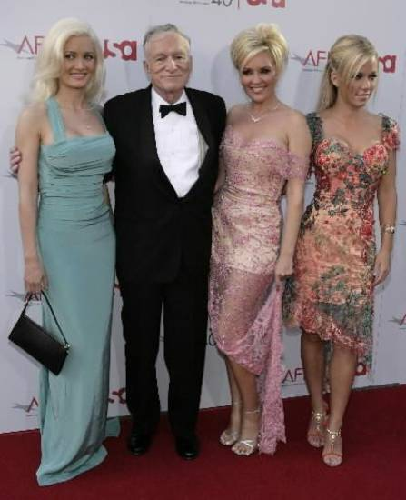 Holly Madison, from left, Hugh Hefner, Bridget Marquardt, and Kendra Wilkinson (AP photo by Matt Sayles)