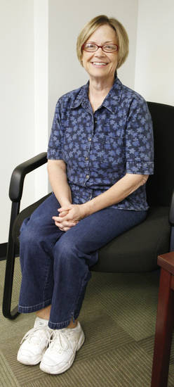 A.J. Legere, of Edmond, sits in her office. Legere lost 115 pounds with dieting and exercise.  Photo by Paul B. Southerland, The Oklahoman