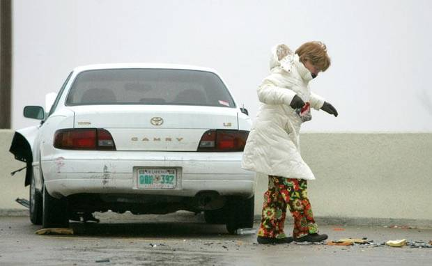Walking cautiously on an ice-covered Broadway Extension, an unidentified women tries to keep her balance after the car she was in was involved in a minor accident near Hefner Road in Oklahoma City, January  26, 2009.  BY STEVE GOOCH, THE  OKLAHOMAN