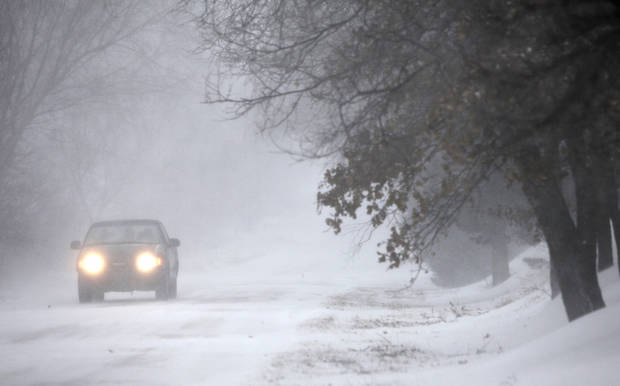 A motorist drives east on Charter Oak road in Logan County, Oklahoma December 24, 2009. Photo by Steve Gooch, The Oklahoman