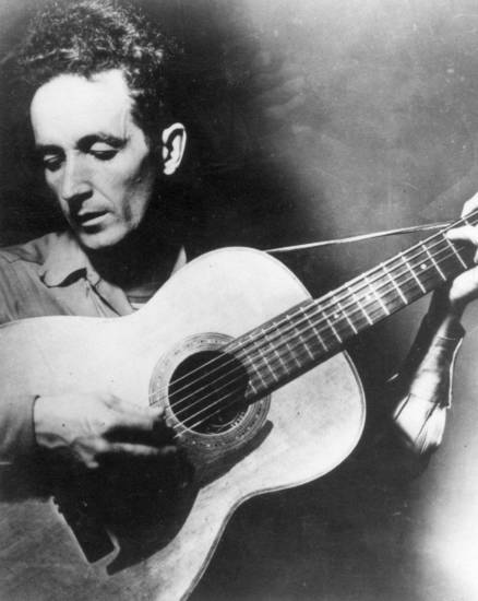 "Oklahoma folk  singer, Woody Guthrie, Okemah, famous for his ballad ""This Land Is Your Land."""