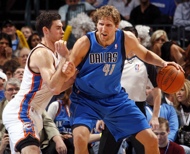 Dallas' Dirk Nowitzki (41) works the ball against Oklahoma City's Nick Collison (4) during the NBA basketball game between the Oklahoma City Thunder and the Dallas Mavericks at Chesapeake Energy Arena in Oklahoma City, Monday, March 5, 2012. The Thunder won, 95-91. Photo by Nate Billings, The Oklahoman