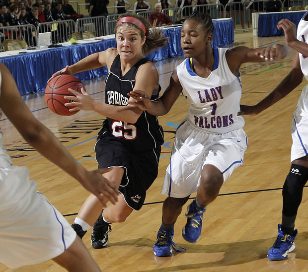 Verdigris' Baileigh O'Dell (25) drives past Millwood's Nykiah Hines (1) during the 3A girls quarterfinals game between Millwood High School and Verdigris High School at the State Fair Arena on Thursday, March 7, 2013, in Oklahoma City, Okla. Photo by Chris Landsberger, The Oklahoman