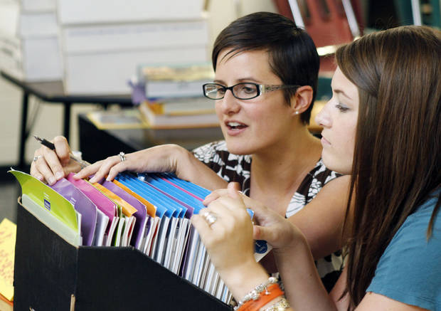 Karielle Rivadeneyra (left) and Morgan Taylor work on a training project together as new teachers go through training sessions at Cooper Middle School in Oklahoma City, OK, Thursday, August 2, 2012,  By Paul Hellstern, The Oklahoman