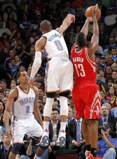 Oklahoma City 's Russell Westbrook (0) blocks a shot by Houston's James Harden (13) during the NBA basketball game between the Houston Rockets and the Oklahoma City Thunder at the Chesapeake Energy Arena on Wednesday, Nov. 28, 2012, in Oklahoma City, Okla.   Photo by Chris Landsberger, The Oklahoman