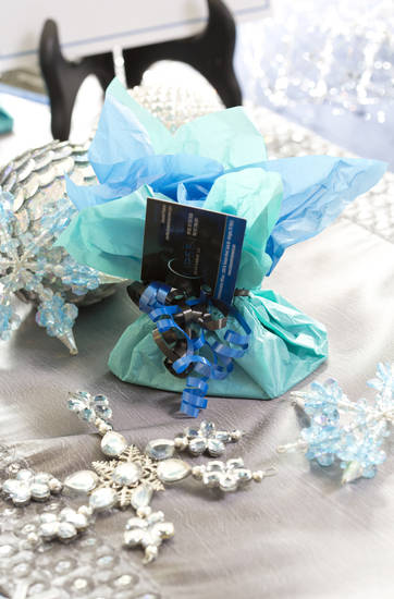 For holiday entertaining try a Jack Frost party theme sending guests home with a party favor such as wine or a white, frost-themed ornament. (Ross Hailey/Fort Worth Star-Telegram/MCT)