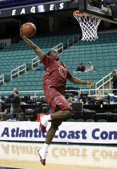 This March 9, 2011, file photo shows Boston College's Reggie Jackson going up to dunk during practice for their NCAA college basketball game at the Atlantic Coast Conference basketball tournament,  in Greensboro, N.C. Jackson is a top prospect for the 2011 NBA draft. (AP Photo/Chuck Burton, File)