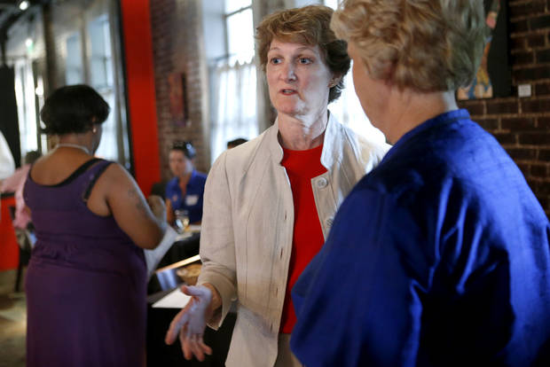 Kay Floyd talks with supporters during her watch party for the Democratic party runoff election in the House District 88 race on Tuesday in Oklahoma City. Photo by Bryan Terry, The Oklahoman <strong>BRYAN TERRY</strong>