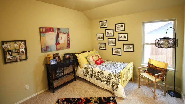 A secondary bedroom in the McCaleb Homes model at 732 Road Not Taken in Edmond. <strong>David McDaniel - The Oklahoman</strong>
