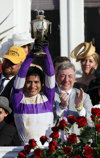 Jockey Mario Gutierrez reacts with owner J. Paul  Reddam after riding I'll Have Another to victory in the 138th Kentucky Derby horse race at Churchill Downs Saturday, May 5, 2012, in Louisville, Ky. (AP Photo/Mark Humphrey)  ORG XMIT: DBY204