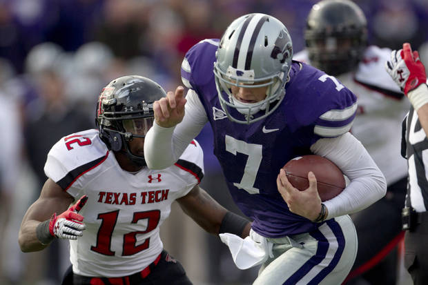 Kansas State quarterback Collin Klein (7) breaks past Texas Tech safety D.J. Johnson (12) for a touchdown during the second half of an NCAA college football game in Manhattan, Kan., Saturday, Oct. 27, 2012. (AP Photo/Orlin Wagner) ORG XMIT: KSOW107