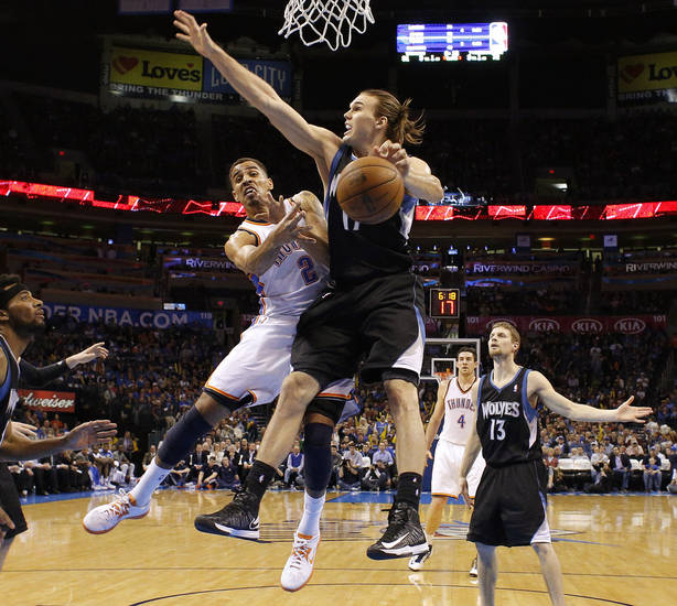 Oklahoma City's Thabo Sefolosha (2) passes the ball past Minnesota's Lou Amundson (17) during an NBA basketball game between the Oklahoma City Thunder and the Minnesota Timberwolves at Chesapeake Energy Arena in Oklahoma City, Wednesday, Jan. 9, 2013.  Oklahoma City won 106-84. Photo by Bryan Terry, The Oklahoman