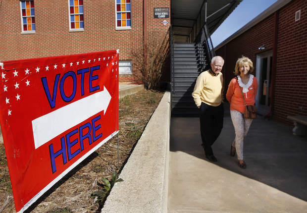 Bill and Berney Porter walking out of Oakdale Baptist Church at Hefner and Sooner Road, after voting in Precinct 108 for the Oklahoma City Council Ward 7 election on Tuesday, March 5, 2013.  Photo by Jim Beckel, The Oklahoman