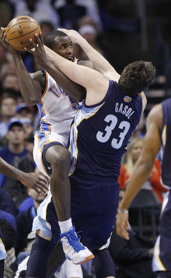 Oklahoma City Thunder forward Serge Ibaka, left, shoots as Memphis Grizzlies center Marc Gasol (33) defends in the second quarter of an NBA basketball game in Oklahoma City, Wednesday, Nov. 14, 2012. (AP Photo/Sue Ogrocki)