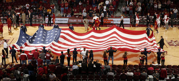 A giant American Flag is unfurled during the pre-game ceremonies as the University of Oklahoma Sooners (OU) men play the Iowa State Cyclones in NCAA, college basketball at Lloyd Noble Center on Saturday, March 2, 2013  in Norman, Okla. Photo by Steve Sisney, The Oklahoman