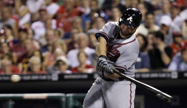 Atlanta Braves' Brian McCann swings on a grand slam off of Philadelphia Phillies relief pitcher Antonio Bastardo in the eighth inning of a baseball game, Friday, July 6, 2012, in Philadelphia. Atlanta won 5-0. (AP Photo/Laurence Kesterson)