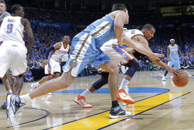 Denver's Danilo Gallinari (8) and Oklahoma City's Thabo Sefolosha (2) battle for a loose ball during the first round NBA playoff game between the Oklahoma City Thunder and the Denver Nuggets on Sunday, April 17, 2011, in Oklahoma City, Okla. Photo by Chris Landsberger, The Oklahoman