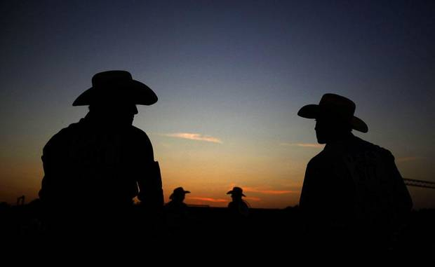 Cowboys wait for their event to start during the International Youth Finals Rodeo in Shawnee, Okla., Sunday, July 10, 2011. Photo by Sarah Phipps, The Oklahoman