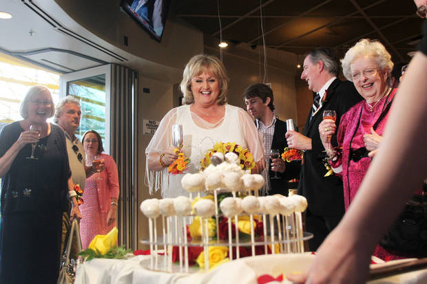 Nancy Levindowski reacts as her wedding cake is wheeled out after exchanging vows with Steve Keller at the Denny's restaurant on Fremont Street in Las Vegas, Wednesday, April 4, 2013. (AP Photo/Las Vegas Sun, Sam Morris)