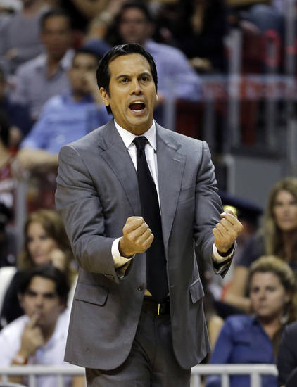 MIami Heat coach Erik Spoelstra reacts after a foul call during the first half of an NBA basketball game against the Sacramento Kings  in Miami, Tuesday, Feb. 26, 2013. (AP Photo/J Pat Carter)