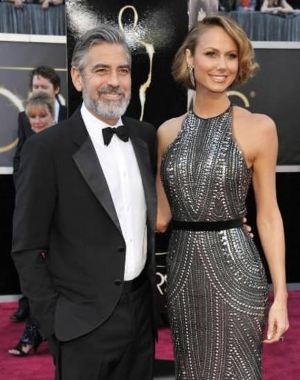 Actor George Clooney, left, and Stacy Keibler arrive at the Oscars at the Dolby Theatre on Sunday Feb. 24, 2013, in Los Angeles. (AP)