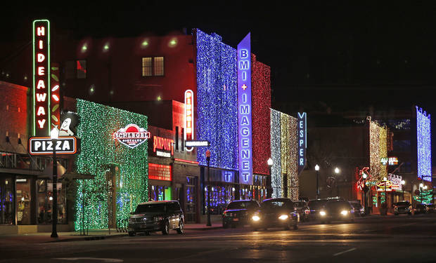 Christmas lights along Broadway in Automobile Alley. Photo by Doug Hoke, The Oklahoman. <strong>DOUG HOKE - THE OKLAHOMAN</strong>