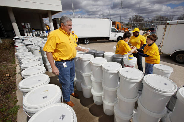 "Sam Porter, left, state director Southern Baptist Disaster Relief, and volunteers preparing 2,000 ""Buckets of Hope for Haiti"" containing food for shipment from the loading dock at the Baptist Building, 3800 N May Avenue, in Oklahoma City Tuesday, March 9, 2010. Photo by Paul B. Southerland, The Oklahoman"