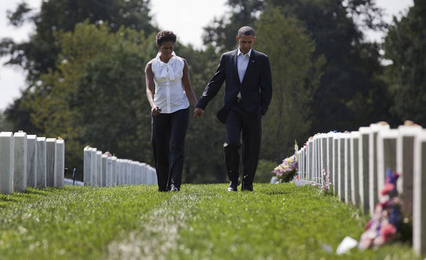 President Barack Obama and first lady Michelle Obama visit Arlington National CemeterySaturday, Sept. 10, 2011, in Arlington, Va. Sunday will mark the 10th anniversary of the Sept. 11 attacks. (AP Photo/Carolyn Kaster)