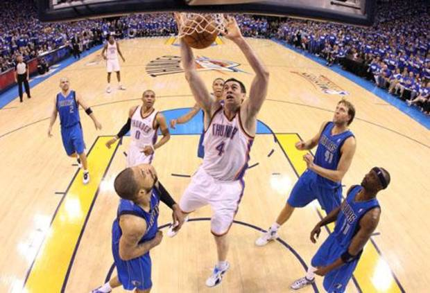 OKLAHOMA CITY, OK - MAY 21:  Nick Collison #4 of the Oklahoma City Thunder dunks the ball while taking on the Dallas Mavericks in Game Three of the Western Conference Finals during the 2011 NBA Playoffs at Oklahoma City Arena on May 21, 2011 in Oklahoma City, Oklahoma. NOTE TO USER: User expressly acknowledges and agrees that, by downloading and or using this photograph, User is consenting to the terms and conditions of the Getty Images License Agreement.  (Photo by Ronald Martinez/Getty Images) *** Local Caption *** Nick Collison