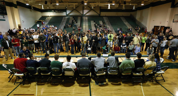Parents, siblings, media and friends take photographs of  senior football players at a signing day assembly at Norman North High School on Wednesday, Feb. 6, 2013, in Norman, Okla.  Photo by Steve Sisney, The Oklahoman