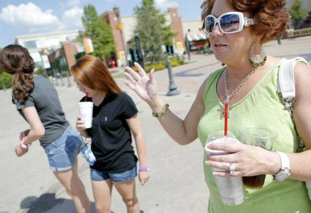 Peggy Hammons (right) talks about the night that her daughter Kelsea (left) and Brittney Campbell (center) were arrested outside Harkins Bricktown Theater in Oklahoma City on Tuesday, July 19, 2011. Photo by John Clanton, The Oklahoman ORG XMIT: KOD