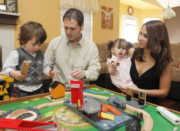 Matias Menis and Diana Miller play with their children Valentin, 3, and Isabella, 11 months, at their home in Norman, OK, Friday, March 11, 2011. By Paul Hellstern, The Oklahoman