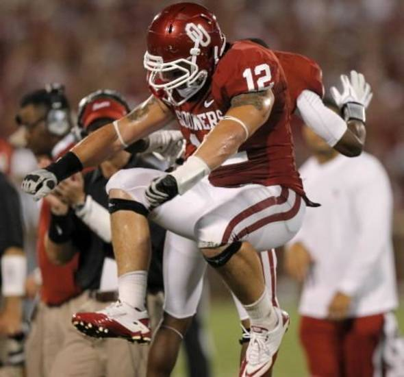 Oklahoma's Tom Wort (12) celebrates after a turnover during the college football game between the University of Oklahoma Sooners ( OU) and the Tulsa University Hurricanes (TU) at the Gaylord Family-Memorial Stadium on Saturday, Sept. 3, 2011, in Norman, Okla. Photo by Bryan Terry, The Oklahoman ORG XMIT: KOD