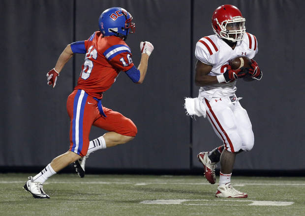 Davis' Deaundre Carr rushes as OCS' Duncan Aldridge chases him down during the Class 2A high school football championships between Davis and Oklahoma Christian School at Boone Pickens Stadium in Stillwater, Okla.,  Saturday,Dec. 8, 2012. Photo by Sarah Phipps, The Oklahoman