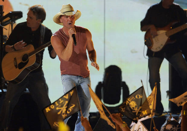 Musician Kenny Chesney performs at the 48th Annual Academy of Country Music Awards at the MGM Grand Garden Arena in Las Vegas on Sunday, April 7, 2013. (Photo by Chris Pizzello/Invision/AP) ORG XMIT: NVPM203