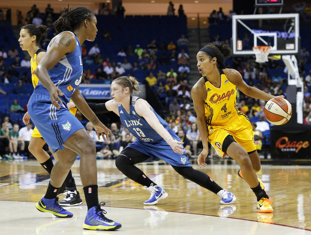 Tulsa's Skylar Diggins (4) tries to get the ball past Minnesota's Rebekkah Brunson (32) and Lindsay Whalen (13) during a game between the Tulsa Shock and the Minnesota Lynx at the BOK Center in Tulsa, Okla., 2013. GARETT FISBECK/The Tulsa World