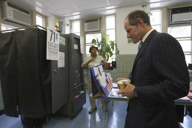 Democratic comptroller hopeful Eliot Spitzer waits his turn to cast his vote in the primary election at his polling station in New York, Tuesday, Sept. 10, 2013.  (AP Photo/Mary Altaffer)