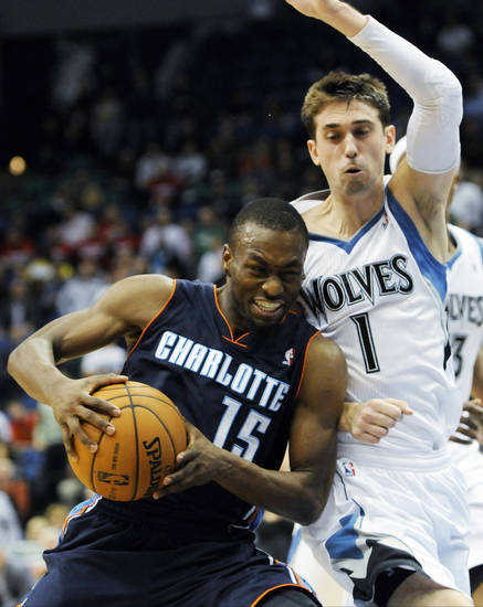 Charlotte Bobcats' Kemba Walker, left, drives around Minnesota Timberwolves' Alexey Shved, of Russia, in the second half of an NBA basketball game, Wednesday, Nov. 14, 2012, in Minneapolis. The Bobcats won 89-87. Walker scored 22 points to lead the Bobcats. (AP Photo/Jim Mone)