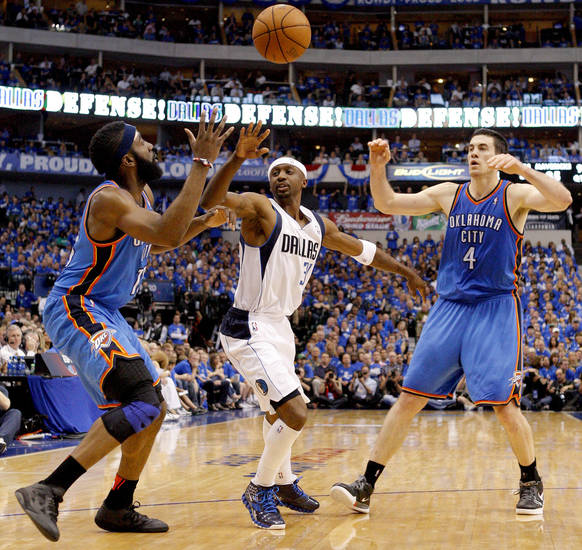 Oklahoma City's Nick Collison (4) passes the ball to James Harden (13) over Jason Terry (31) of Dallas during game 2 of the Western Conference Finals in the NBA basketball playoffs between the Dallas Mavericks and the Oklahoma City Thunder at American Airlines Center in Dallas, Thursday, May 19, 2011. Photo by Bryan Terry, The Oklahoman