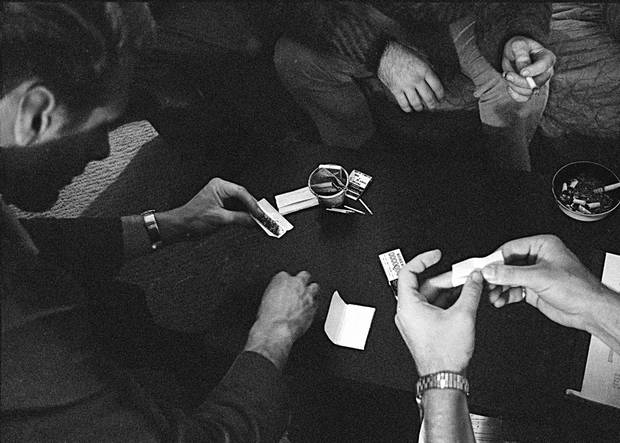 "FILE - In this May 23, 1966, file photo, people roll joints at a marijuana party near the University of California at Berkeley campus in Berkeley, Calif. In 2012, Washington state and Colorado voted to legalize and regulate its recreational use. But before that, the plant, renowned since ancient times for its strong fibers, medical use and mind-altering properties, was a staple crop of the colonies, an ""assassin of youth,"" a counterculture emblem and a widely accepted - if often abused - medicine. On the occasion of  �Legalization Day,� Thursday, Dec. 6, 2012, when Washington�s new law takes effect, AP takes a look back at the cultural and legal status of the �evil weed� in American history. (AP Photo/File)"