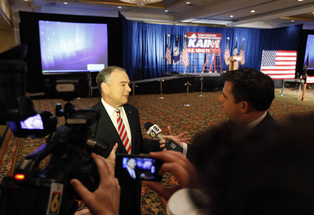 Democratic senatorial candidate Timothy Kaine talks with media at the site of his election night party in Richmond, Va., Tuesday, Nov. 6, 2012. Kaine is facing former senator Republican George Allen. (AP Photo/Steve Helber)