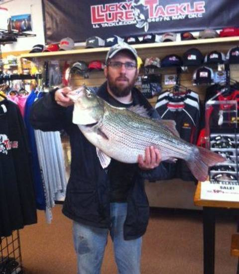 Lambert Dunn caught this 17.9-pound striped bass hybrid at Lake Hefner on Saturday. The fish has been submitted to the Oklahoma Department of Wildlife Conservation as a new lake record.