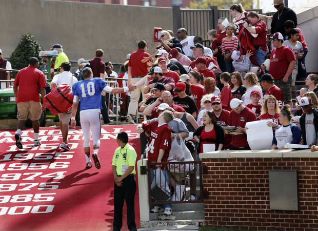 Quarterback Blake Bell shakes hands with fans on his way to the interview room after the annual Spring Football Game at Gaylord Family-Oklahoma Memorial Stadium in Norman, Okla., on Saturday, April 13, 2013. Photo by Steve Sisney, The Oklahoman