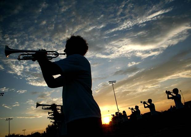 Zach Truett, a sophomore, practices with the trumpet section during marching band practice at Edmond North High School in Edmond, Okla., on Monday, August 9, 2010. Photo by John Clanton, The Oklahoman ORG XMIT: KOD
