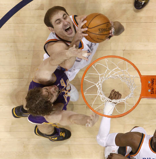 Oklahoma City&#039;s Nenad Krstic goes for the ball beside Pau Gasol of Los Angeles during the NBA basketball game between the Los Angeles Lakers and the Oklahoma City Thunder in the first round of the NBA playoffs at the Ford Center in Oklahoma City, Thursday, April 22, 2010. Photo by Bryan Terry, The Oklahoman 