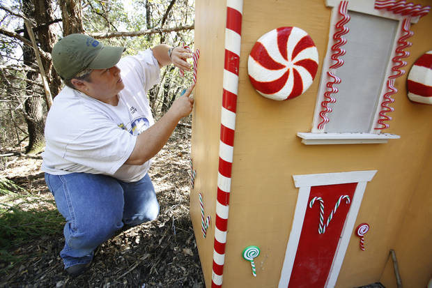 PREPARE / PREPARATION / SET UP: Nicole Offutt decorates the Storybook Forest for this year's Halloween event at Lake Arcadia in Edmond, Thursday October 18, 2012. Photo By Steve Gooch, The Oklahoman <strong>Steve Gooch - The Oklahoman</strong>